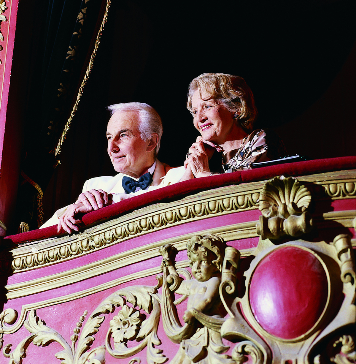 Mature Couple Sitting in a Theatre Balcony